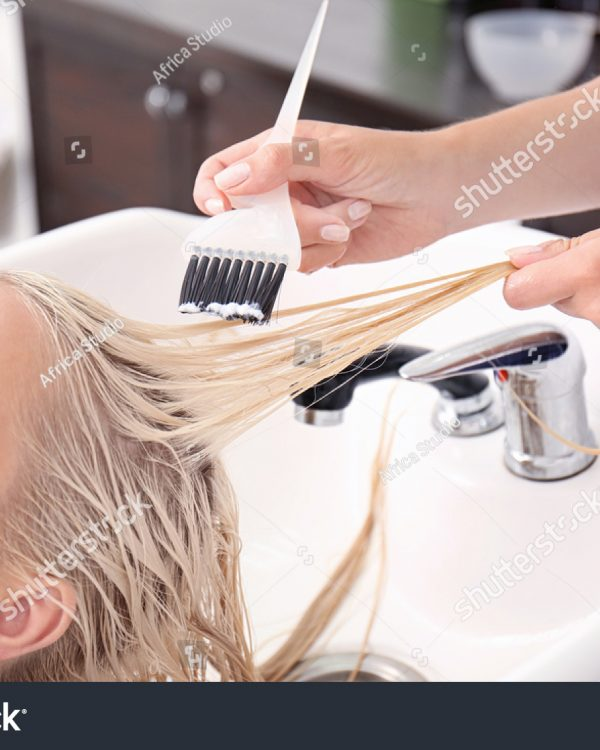 stock-photo-hairdresser-putting-mask-on-woman-s-hair-in-salon-536525845