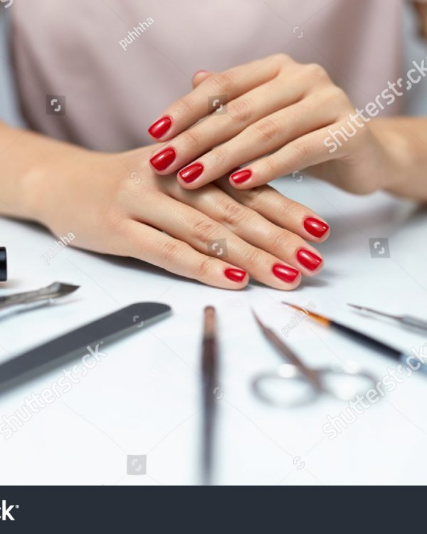 stock-photo-nail-care-closeup-of-beautiful-woman-hands-showing-perfect-nails-painted-with-red-nail-polish-on-550897681