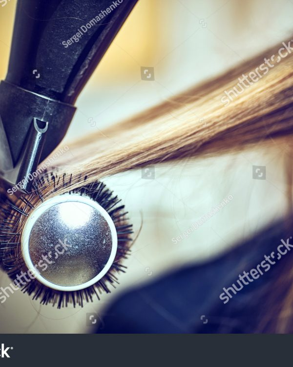 stock-photo-professional-hairdresser-drying-hair-in-studio-578124061